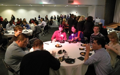 Students, scholars, alumni and guests enjoying the event