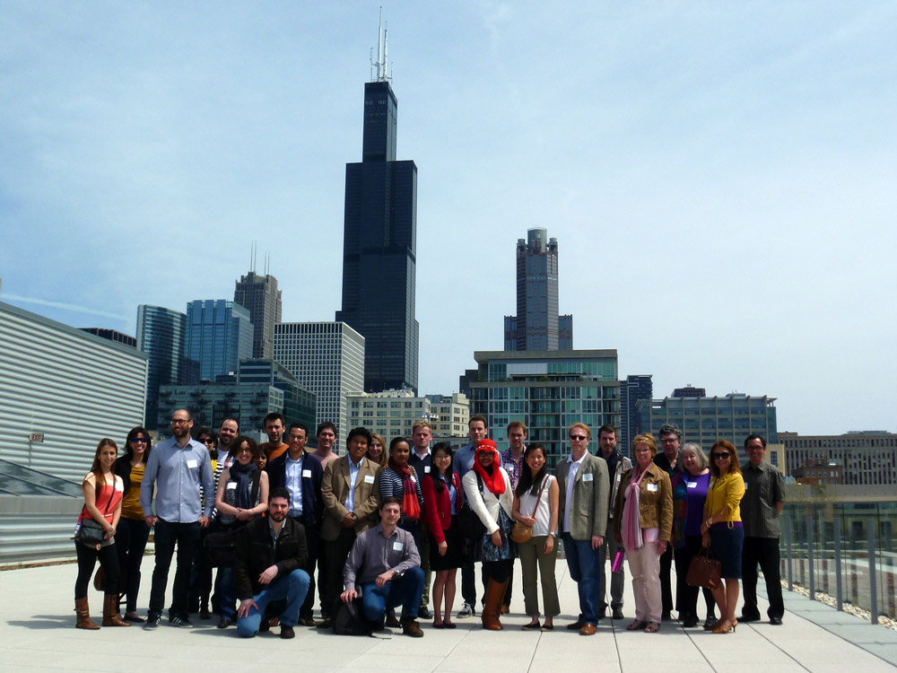 The first group of participants pose at the rooftop of the museum