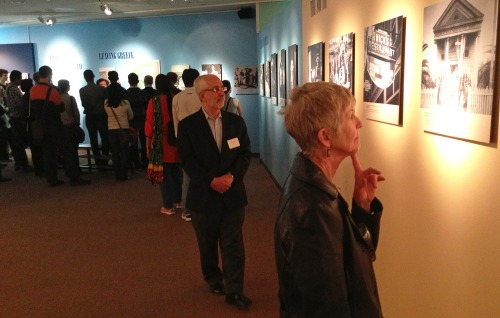 Participants observe the historical photographs of the exhibit