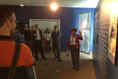 The second group listens to the tour guide, a passionate descendant of Greek immigrants