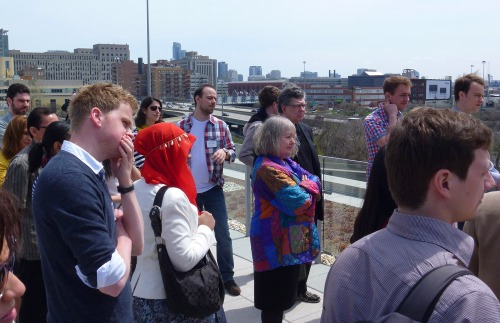 Participants listening to the tour guide at the rooftop