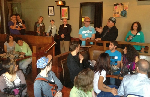 Participants listen to the presentation at Simone's, prior to start the Pilsen neighborhood tour