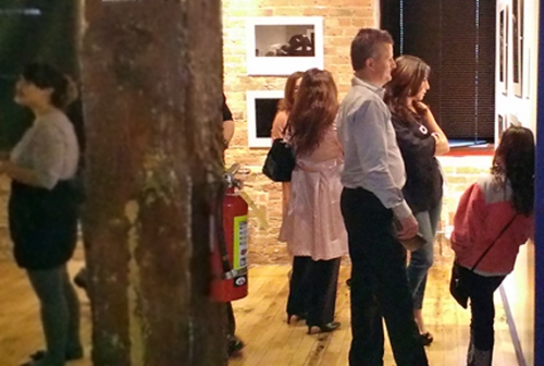 Guests watching the photo exhibit