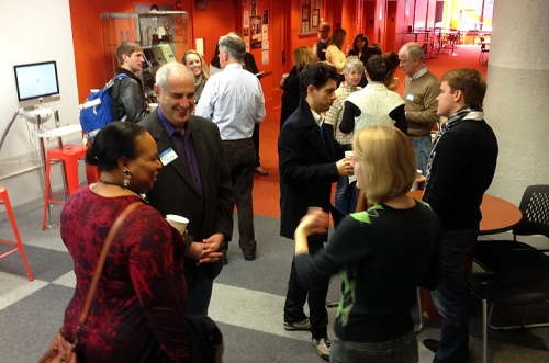 Participants networking in the Orange Area of the Journalism department of Columbia College Chicago during a break.