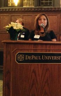 Past award recipient, Dr. Ana Gil García announces this year's winner.