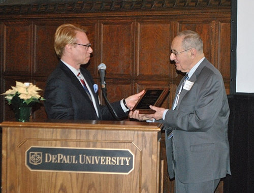 Ron Harvey, President of the Chicago Chapter of the Fulbright Association, presented Dr. Douglas with the Fulbright Pioneer Award
