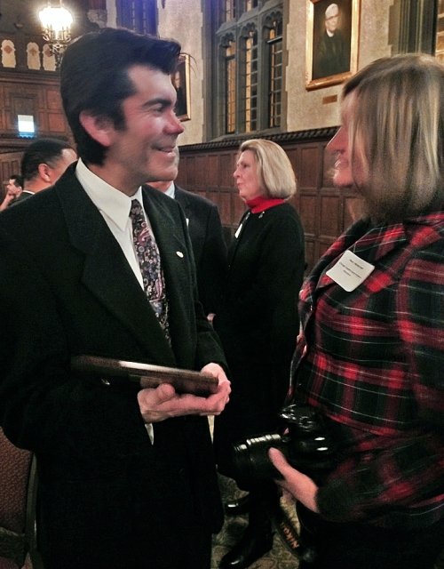 Elio Leturia talks to Chicago Chapter board member Mary Mares-Awe after being presented with the Dee Sarelas Service Award.