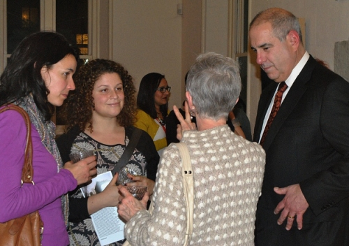 Regina Sisson, Jenni Schneiderman and Fred Siegman chatting with other Fulbright Association members during the reception