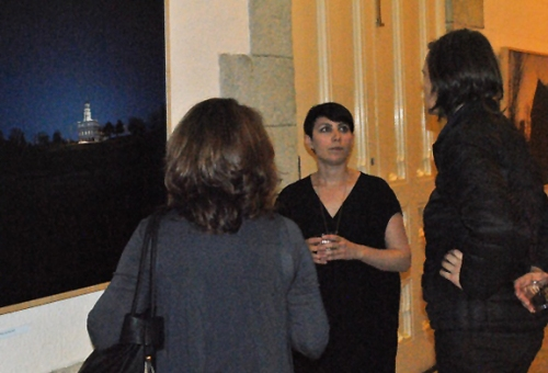 Regina Mamou discussing her work with the reception guests