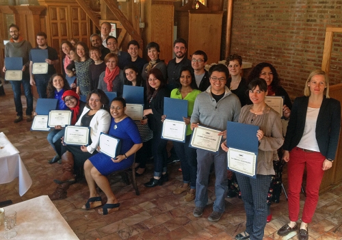 Fulbright students and scholars who have finished with their programs receive a certificate of completion by the Chicago Chapter of the Fulbright Association