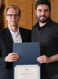 President Ron Harvey with Rodrigo Batista and his certificate of completion