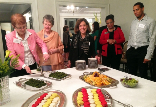 Dr. Marilyn Susman (center) board member of the Chicago Chapter, at the dessert table