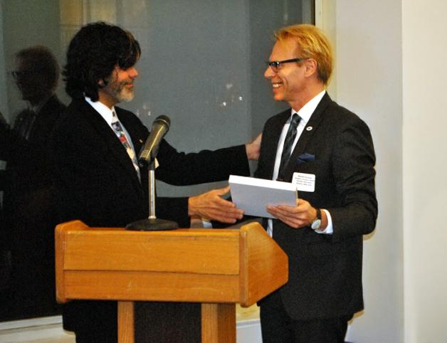 Last year Dee Sarelas Service Award Elio Leturia presenting Ron Harvey with the 2014 award.