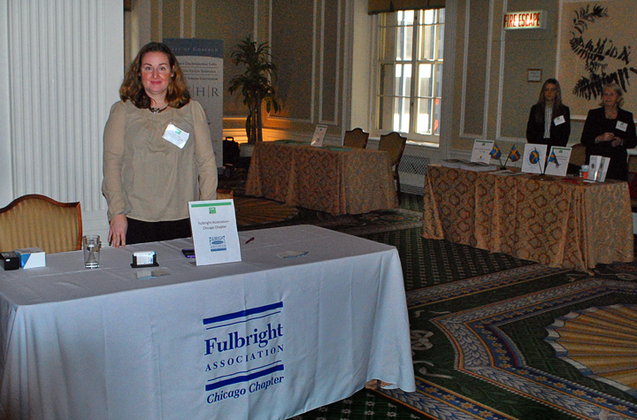 Chicago Chapter Board  Member Meredith Mc Neil at the Fulbright table during the fair prior to the luncheon
