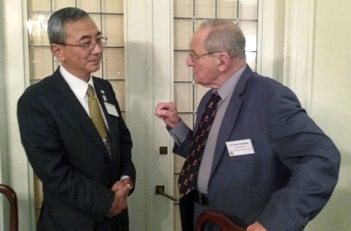 Dr. Bruce Douglas and Hon. Consul General of Japan, Toshiyuki Iwado discussing education issues during a recent reception at the consul's residence.